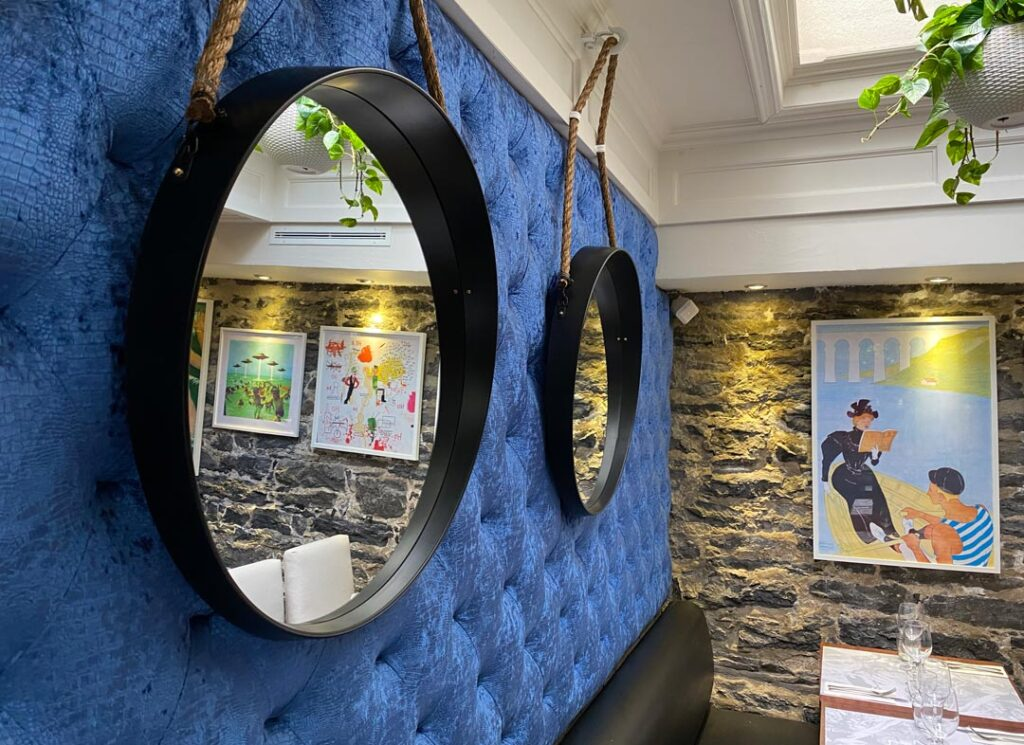 Restaurant le Polisson decor in Old Montreal with art exhibit